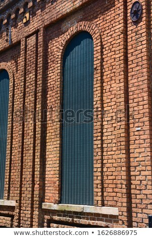 A window and the tall stonewall Stock photo © bluering
