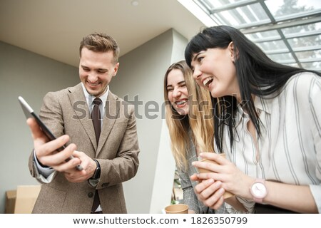 Happy Businessman Demonstrating His Project stock photo © MilanMarkovic78