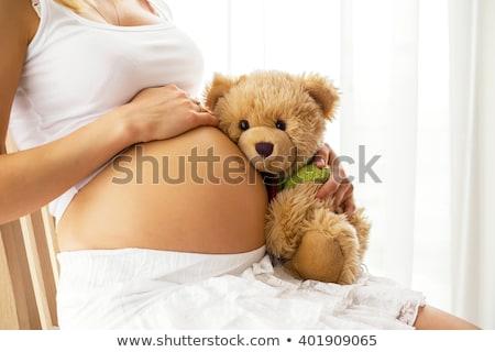 donna · incinta · cute · orsacchiotto · seduta · pancia · donna - foto d'archivio © iko