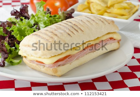 tasty sandwiches with ham cheese lettuce tomato and a bowl of stock photo © vlad_star