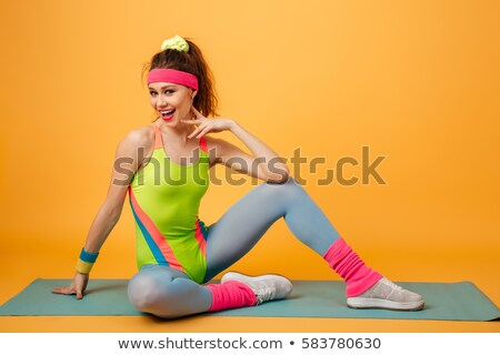 Incredible young fitness woman make sport exercises Stock photo © deandrobot