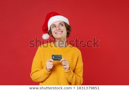 Fiatal töprengő nő piros kalap ül Stock fotó © deandrobot