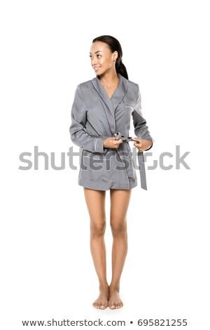 Függőleges kép nő fürdőköpeny másfelé néz gyömbér Stock fotó © deandrobot