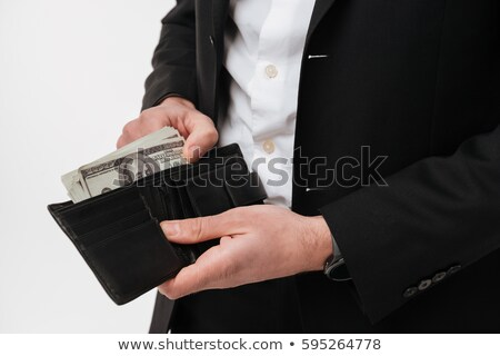 Cropped image of businessman holding purse full of money. Stock photo © deandrobot