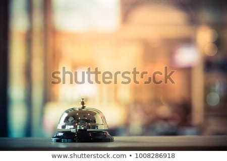 Foto stock: Vintage Service Bell At Old Hotel Reception Desk