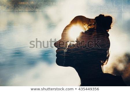 Sentido surreal homem em pé chuva voador Foto stock © psychoshadow
