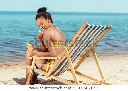афроамериканец женщину солнечные ванны красивой песчаный Сток-фото © PawelSierakowski