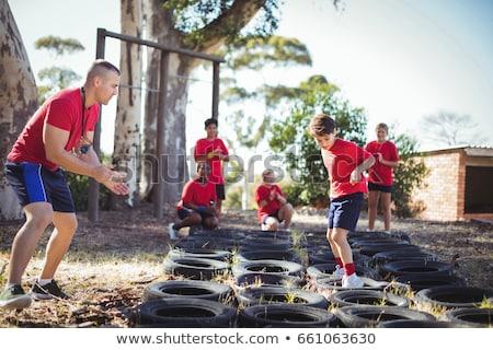 treinador · treinamento · crianças · bota · acampamento - foto stock © wavebreak_media
