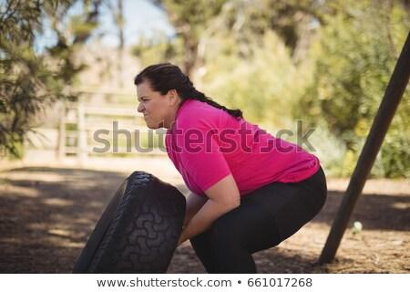 определенный женщину огромный шин Сток-фото © wavebreak_media