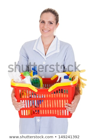 Stock photo: Young woman with scrub brush and cleansing spray isolated