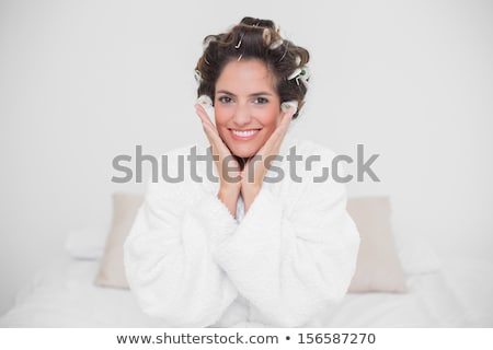 Pretty woman in a dressing-gown and curlers stock photo © julenochek