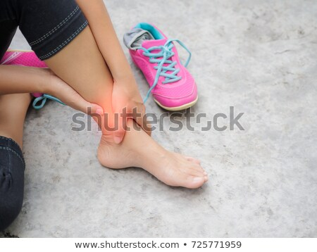 Fit woman with ankle injury Stock photo © wavebreak_media