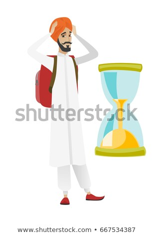worried hindu traveler man looking at hourglass stock photo © rastudio