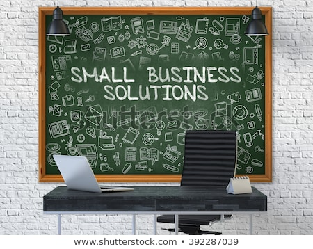 chalkboard on the office wall with small business strategy stock photo © tashatuvango
