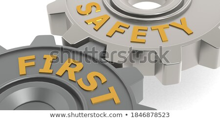 safety first on golden metallic gears stock photo © tashatuvango
