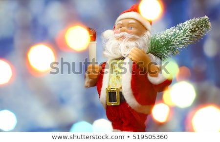 Kerstman speelgoed kerstboom Blauw nacht bokeh Stockfoto © TanaCh