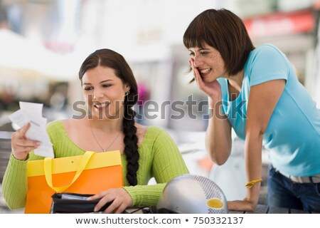 Stock photo: woman with shoppingbag and receipt