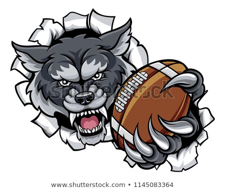 Сток-фото: Wolf American Football Mascot Breaking Background