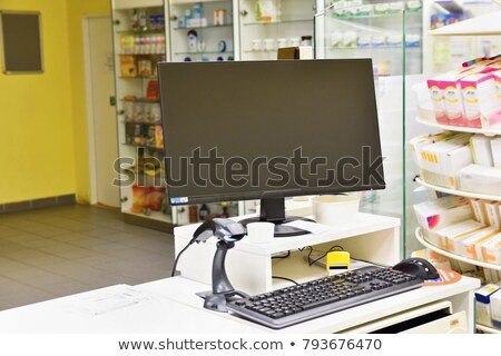 Pharmacist at counter with computer monitor. Stock photo © RAStudio