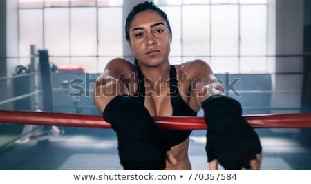 Feminino boxeador em pé dentro boxe anel Foto stock © NeonShot