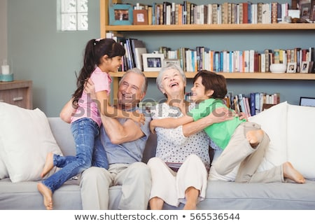 Mujer nietos estantería amor educación diversión Foto stock © IS2
