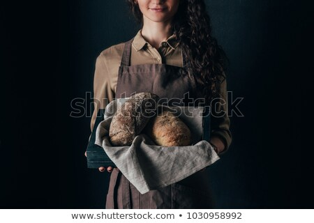 cropped shot of woman holding wooden box with loafs of bread in hands Stock photo © LightFieldStudios