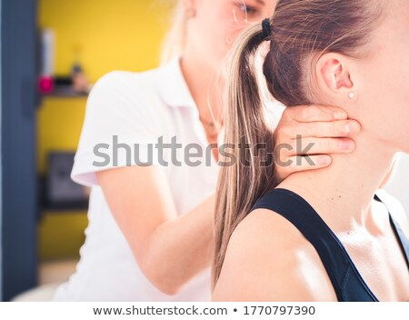 Physio treating senior patient  Stock photo © Kzenon