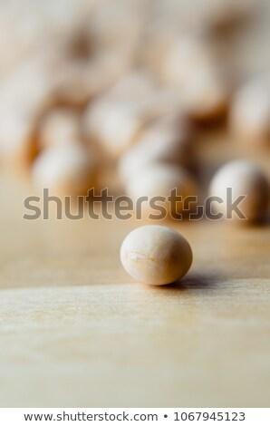 Scattered Soya Beans on Light Wood Table Stock photo © frannyanne