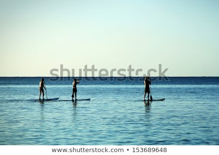 Three people standing with surfboards Stock photo © IS2