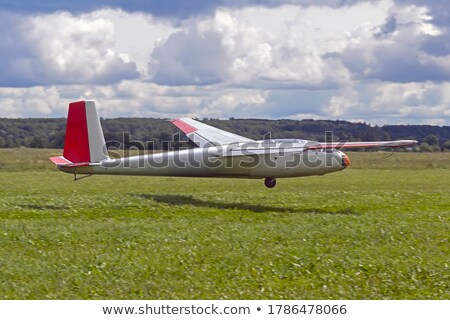 Sport piloot landing propeller vliegtuigen hemel Stockfoto © Kzenon