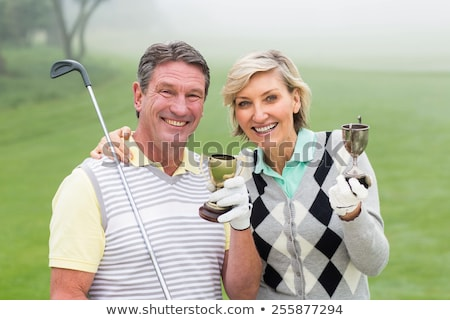 Senior couple with golf trophy smiling Stock photo © IS2