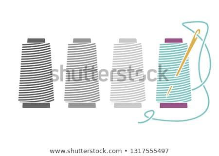 Carretel fio agulha branco isolado azul Foto stock © OleksandrO