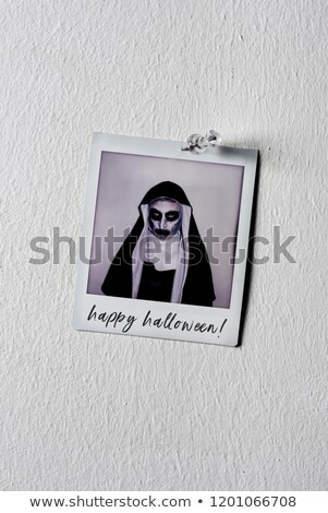 picture of an evil nun and text happy halloween stock photo © nito
