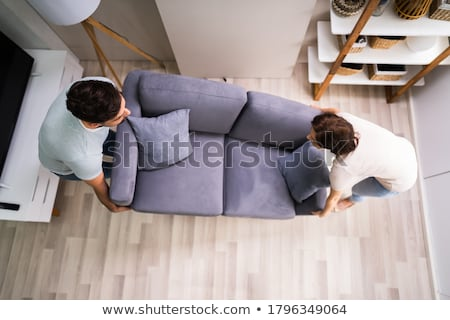 Movers Carrying Sofa With Family Stock photo © AndreyPopov