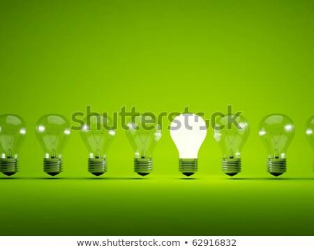 Stock photo: Green light bulb in a row of bulbs