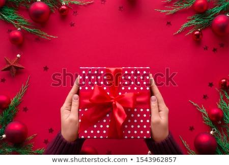 woman preparing a Christmas present Stock photo © choreograph