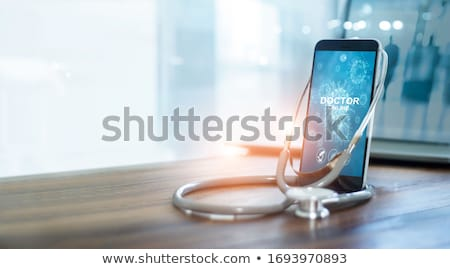 Mobiele telefoon stethoscoop houten hout telefoon achtergrond Stockfoto © OleksandrO