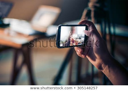 smartphone in hand and recording video Stock photo © romvo