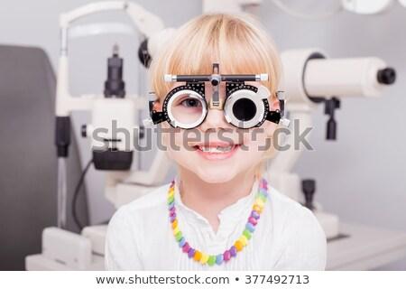 Girl Checking Her Eyesight Stock photo © AndreyPopov
