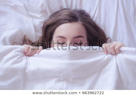 nő · ágy · kéz · ébresztőóra · ingerült · fiatal · nő - stock fotó © galitskaya