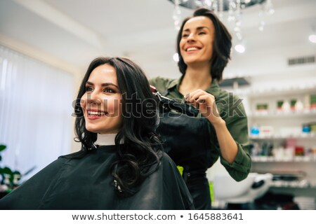 Woman Stylist Using Hair Dryer Make Client Haircut Stock photo © robuart
