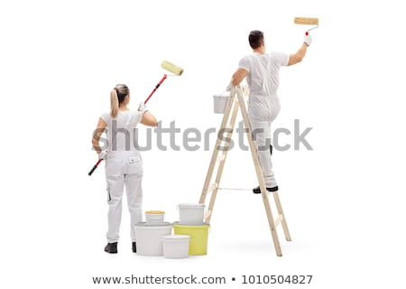 two female worker painting the wall stock photo © kzenon