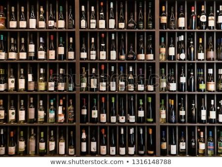 bottles of wine on the shelves in a rack stock photo © dashapetrenko