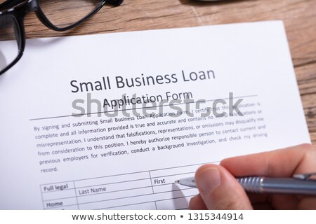 Businessperson Filling Small Business Loan Application Form Stock photo © AndreyPopov