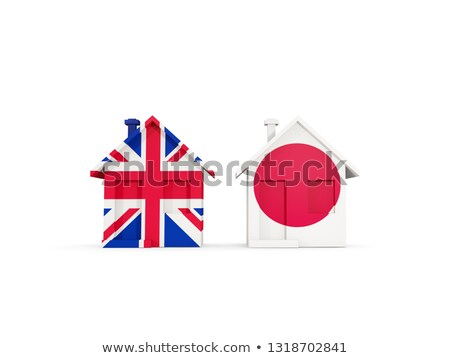 Two houses with flags of United Kingdom and japan Stock photo © MikhailMishchenko