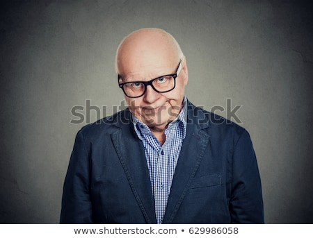 frown man with eyeglasses looking angry Stock photo © feedough