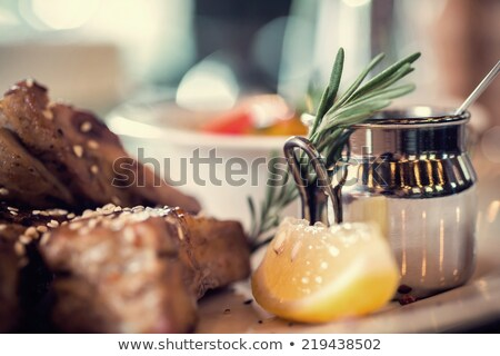 close up of spicy marinated meat on kitchen table Stock photo © dolgachov