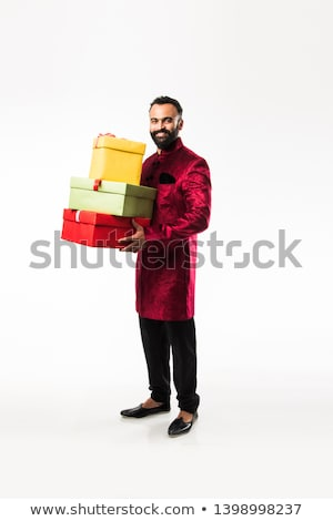 Indian young man in the traditional clothing isolated on white i Stock photo © NikoDzhi