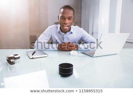 Draadloze spreker zakenman werken bureau Stockfoto © AndreyPopov