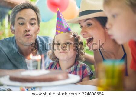 Jovem mãe ajuda pequeno crianças soprar Foto stock © pressmaster
